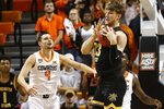 Wichita State center Asbjorn Midtgaard (33) grabs a rebound in front of Oklahoma State guard Thomas Dziagwa in the first half of an NCAA college basketball game in Stillwater, Okla., Sunday, Dec. 8, 2019. (AP Photo/Sue Ogrocki)