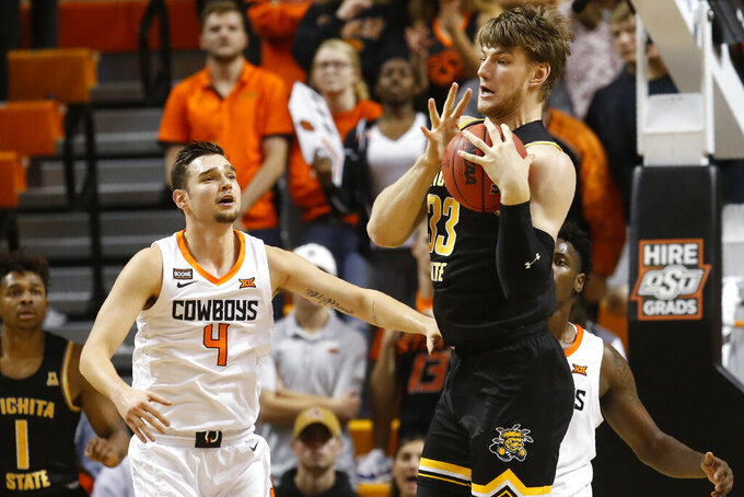 Etienne, hot shooting leads Wichita St. over Okla. St. 80-61