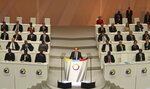 FILE - In this Oct. 13 2012 file photo shot by AP contributing photographer John Bompengo, French President Francois Hollande speaks during the opening session of the Francophonie Summit, in Kinshasa, Democratic Republic of Congo. Relatives say longtime Associated Press contributor John Bompengo has died of COVID-19 in Congo's capital. Bompengo, who had covered his country's political turmoil over the course of 16 years, died Saturday, June 20, 2020 at a Kinshasa hospital. (AP Photo/John Bompengo, file)