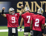 New Orleans Saints quarterback Drew Brees (9) reacts to beating the other quarterbacks to the tape during NFL football training camp Saturday, Aug. 29, 2020, in New Orleans. (David Grunfeld/The Advocate via AP, Pool)