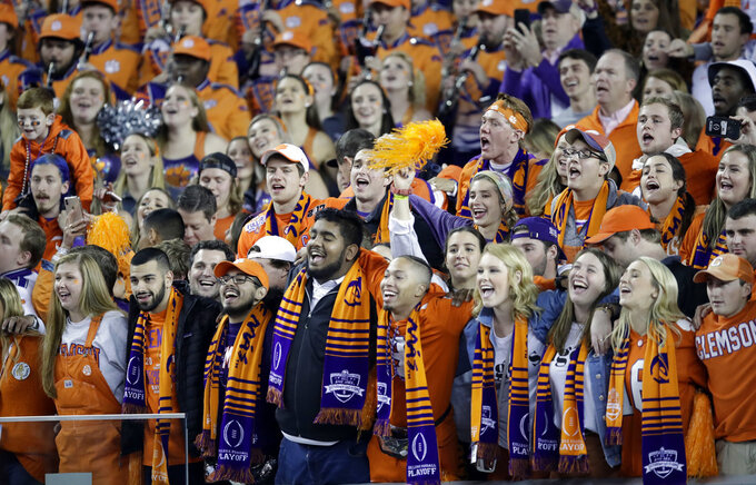 Clemson fans celebrate after the NCAA college football playoff championship game against Alabama, Monday, Jan. 7, 2019, in Santa Clara, Calif. Clemson beat Alabama 44-16. (AP Photo/Ben Margot)
