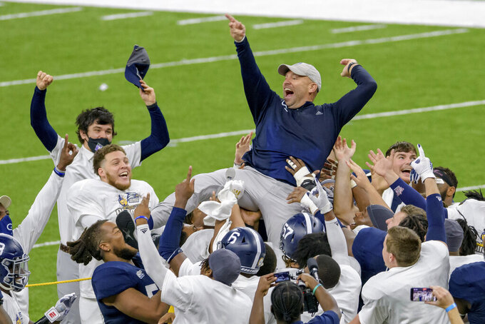 Georgia Southern coach Chad Lunsford celebrates the team's victory over Louisiana Tech in the New Orleans Bowl NCAA college football game in New Orleans, Wednesday, Dec. 23, 2020. (AP Photo/Matthew Hinton)