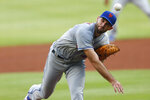 New York Mets starting pitcher Michael Wacha works in the first inning of the team's baseball game against the Atlanta Braves on Saturday, Aug. 1, 2020, in Atlanta. (AP Photo/John Bazemore)