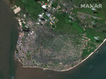 Satellite image provided by DigitalGlobe, photo showing aerial view of Beira city, Mozambique, on the shores of the Indian Ocean, dated March 13, 2019, before the impact of cyclone Idai on the area.  A second week has begun of efforts to find and help some tens of thousands of people after Cyclone Idai devastated parts of southern Africa, with some hundreds dead and an unknown number of people still missing. (DigitalGlobe, a Maxar company via AP)