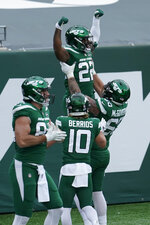 New York Jets' La'Mical Perine (22), top, celebrates his touchdown with teammates during the first half of an NFL football game against the Buffalo Bills, Sunday, Oct. 25, 2020, in East Rutherford, N.J. (AP Photo/Frank Franklin II)