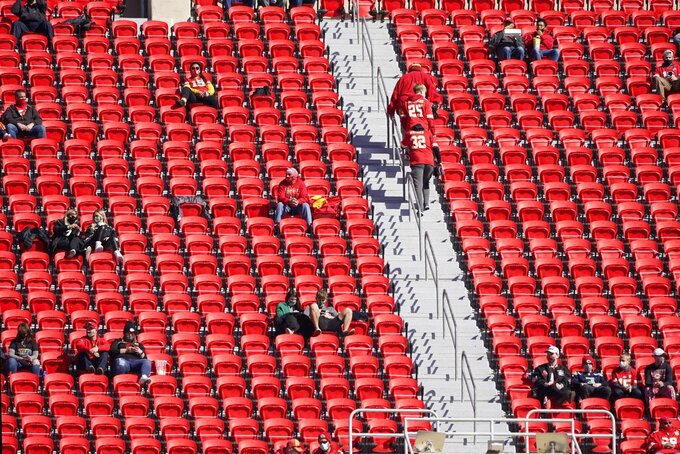 Fans arrive at Arrowhead Stadium for an NFL football game between the New York Jets and Kansas City Chiefs on Sunday, Nov. 1, 2020, in Kansas City, Mo. (AP Photo/Charlie Riedel)