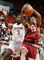 Washington State forward Robert Franks (3) and Stanford forward Oscar da Silva (13) go after a rebound during the second half of an NCAA college basketball game in Pullman, Wash., Saturday, Jan. 19, 2019. Stanford won 78-66. (AP Photo/Young Kwak)