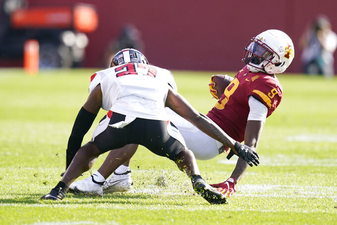 Iowa State wide receiver Joe Scates (9) is tackled by Texas Tech defensive back Alex Hogan (27) after catching a pass during the first half of an NCAA college football game, Saturday, Oct. 10, 2020, in Ames, Iowa. (AP Photo/Charlie Neibergall)