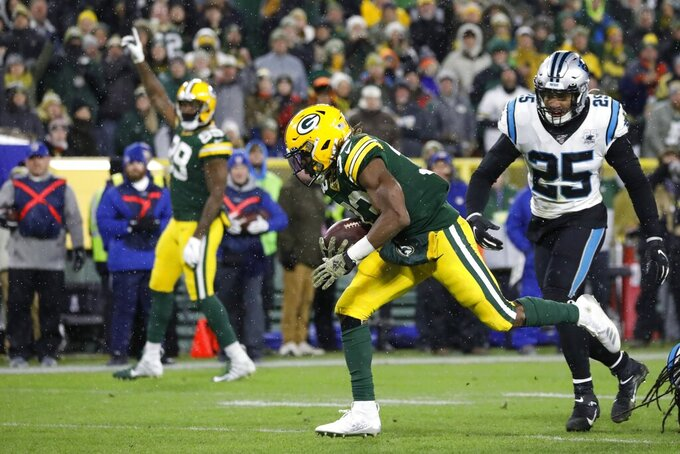 Green Bay Packers' Aaron Jones runs for a touchdown during the second half of an NFL football game against the Carolina Panthers Sunday, Nov. 10, 2019, in Green Bay, Wis. (AP Photo/Jeffrey Phelps)