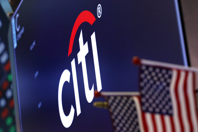 FILE - In this Feb. 8, 2019, file photo, the logo for Citigroup appears above a trading post on the floor of the New York Stock Exchange.  Citigroup's fourth-quarter profits rose by 15% from a year earlier, as the bank benefited from a boost in trading similar to its competitor JPMorgan Chase. Citi said Tuesday, Jan. 14, 2020,  that bond trading revenues were up 49% from a year earlier, when a steep downfall in the last quarter of 2018 took its toll on all banks' trading desks.  (AP Photo/Richard Drew, File)