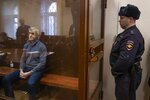 Founder of the Baring Vostok investment fund Michael Calvey looks through a cage's class in the court room in Moscow, Russia, Saturday, Feb. 16, 2019. A Moscow court has ordered Baring Vostok's founder Michael Calvey to be kept in custody until April 13, 2019. (AP Photo/Alexander Zemlianichenko)