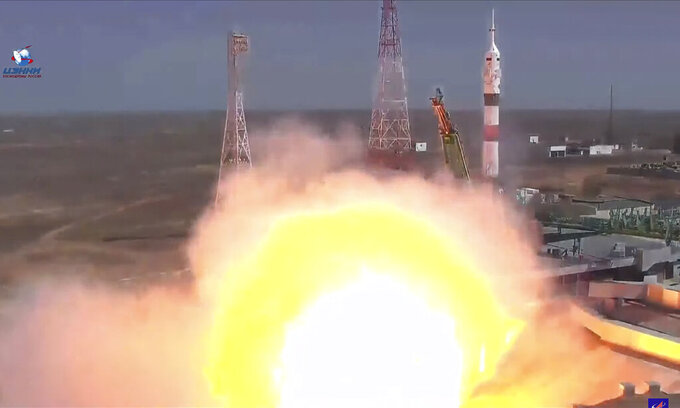 In this photo taken from video footage released by the Roscosmos Space Agency, the Soyuz-2.1a rocket booster with Soyuz MS-18 space ship carrying a new crew to the International Space Station, ISS, blasts off at the Russian leased Baikonur cosmodrome, Kazakhstan, Friday, April 9, 2021. A Russian-U.S. trio of space travelers have launched successfully, heading for the International Space Station. NASA astronaut Mark Vande Hei and Russian cosmonauts Oleg Novitskiy and Pyotr Dubrov blasted off as scheduled at 12:42 p.m. (0742 GMT, 3:42 a.m. EDT) Friday aboard the Soyuz MS-18 spacecraft from the Russia-leased Baikonur launch facility in Kazakhstan. (Roscosmos Space Agency via AP)
