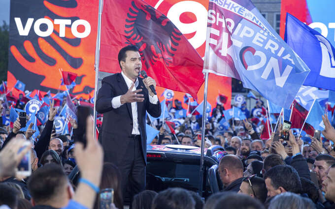 Supporters of the Democratic Party waving Albanian and party flags participate in the political rally in capital Tirana, Albania on Friday, April 23, 2021.Albania holds parliamentary elections on Sunday amid the virus pandemic and a bitter political rivalry between the country's two largest political parties but that will serve as a key milestone in the country's next step toward European Union membership. (AP Photo/Visar Kryeziu)