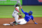 Toronto Blue Jays' Marcus Semien (10) beats the tag at second by Miami Marlins shortstop Jazz Chisholm Jr. (2) on a groundout by Bo Bichette during the fifth inning of a baseball game in Buffalo, N.Y., Tuesday, June 1, 2021. (AP Photo/Adrian Kraus)