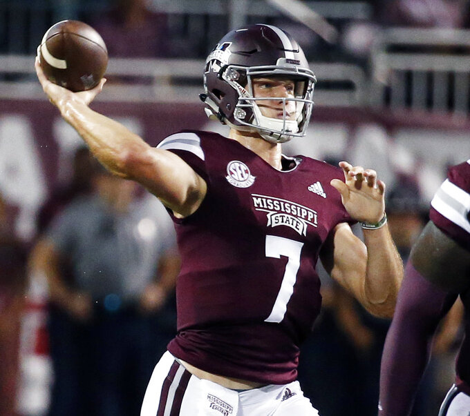 Mississippi State quarterback Nick Fitzgerald (7) passes against Auburn during the first half of their NCAA college football game in Starkville, Miss., Saturday, Oct. 6 2018. (AP Photo/Rogelio V. Solis)