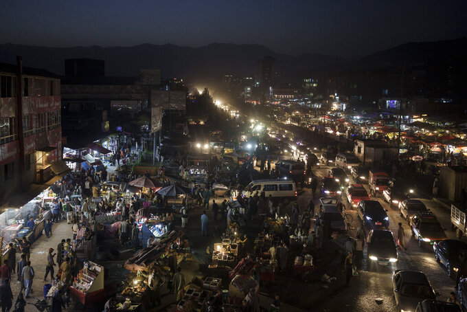 Afghans shop at a local market in Kabul, Afghanistan, Sunday, Sept. 26, 2021. (AP Photo/Felipe Dana)