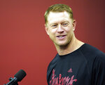 Nebraska head coach Scott Frost speaks during an NCAA college football news conference in Lincoln, Neb., Thursday, Aug. 2, 2018, Frost has said repeatedly that Nebraska made a mistake moving away from the methods Osborne successfully used. Frost's job is to return his team to the place it held in the college football hierarchy two decades ago by returning to the methods Osborne used on and off the field to make the Cornhuskers great. 2018. (AP Photo/Nati Harnik)