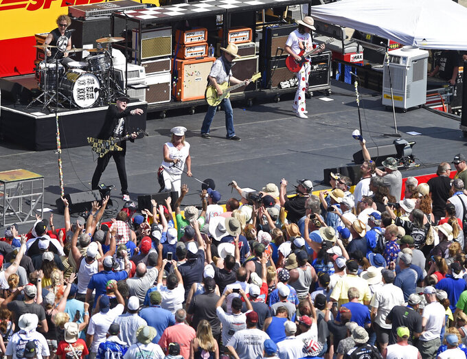 Cheap Trick performs during pre-race activities before the NASCAR Cup Series auto race at Charlotte Motor Speedway in Concord, N.C., Sunday, May 26, 2019. (AP Photo/Mike McCarn)