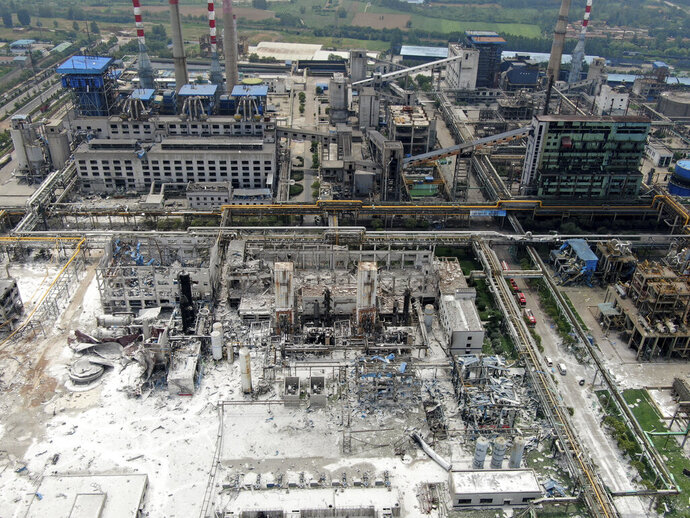 An aerial view shows the aftermath of the blast at a gas plant in Yima city in central China's Henan province Saturday, July 20, 2019. The Friday evening explosion shattered windows 3 kilometers (1.9 miles) away, and knocked off doors inside buildings, killing some and injuring others. (Chinatopix via AP)