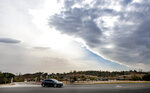 In a view from Peters Canyon Regional Park in Orange, Calif., a line of storm clouds moves across Orange County as strong Santa Ana winds began to blow early Tuesday afternoon, Jan. 19, 2021, throughout Orange County and Southern California. (Mark Rightmire/The Orange County Register via AP)
