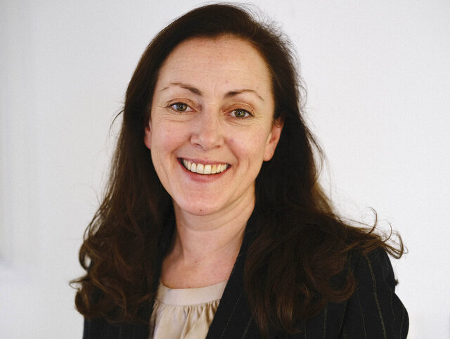 In this photo taken Feb. 12, 2020 Susie Blann, AP's head of planning for Europe and Africa, poses for a photo in London. Blann, who has helped lead video coverage through Europe and Africa, has been named by The Associated Press as its United Kingdom and Ireland news director and special events editor. The AP made the announcement March 19, 2020. (AP Photo/Sam Wells)