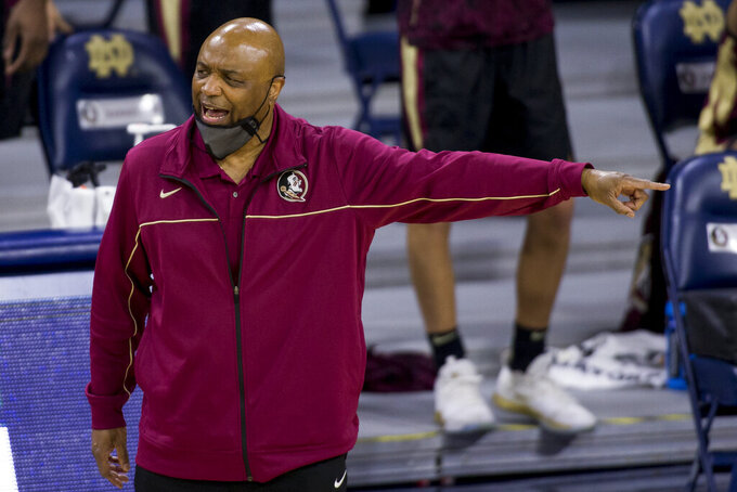 Florida State head coach Leonard Hamilton directs players during the first half of an NCAA college basketball game against Notre Dame on Saturday, March 6, 2021, in South Bend, Ind. Notre Dame won 83-73. (AP Photo/Robert Franklin)