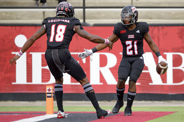 Louisiana-Lafayette running back Chris Smith (21) celebrates a touchdown with Louisiana-Lafayette wide receiver Jalen Williams (18) in the first half of an NCAA college football game against South Alabama in Lafayette, La., Saturday, Nov. 14, 2020. (AP Photo/Matthew Hinton)