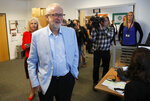 Britain's opposition leader Jeremy Corbyn arrives to meet business leaders at the Business and Technology Centre, Stevenage, England, Tuesday Aug. 20, 2019, to discuss the impact of leaving the EU without a deal. (AP Photo/Frank Augstein)
