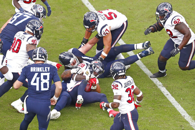 Houston Texans defensive back Michael Thomas (28) recovers a blocked field goal attempt by the Tennessee Titans in the second half of an NFL football game Sunday, Oct. 18, 2020, in Nashville, Tenn. (AP Photo/Wade Payne)