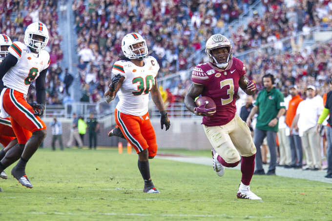 Florida State Seminoles running back Cam Akers (3) heads toward the end zone on an 18-yard reception in the second half of an NCAA college football game against Miami in Tallahassee, Fla., Saturday, Nov. 2, 2019. (AP Photo/Mark Wallheiser)