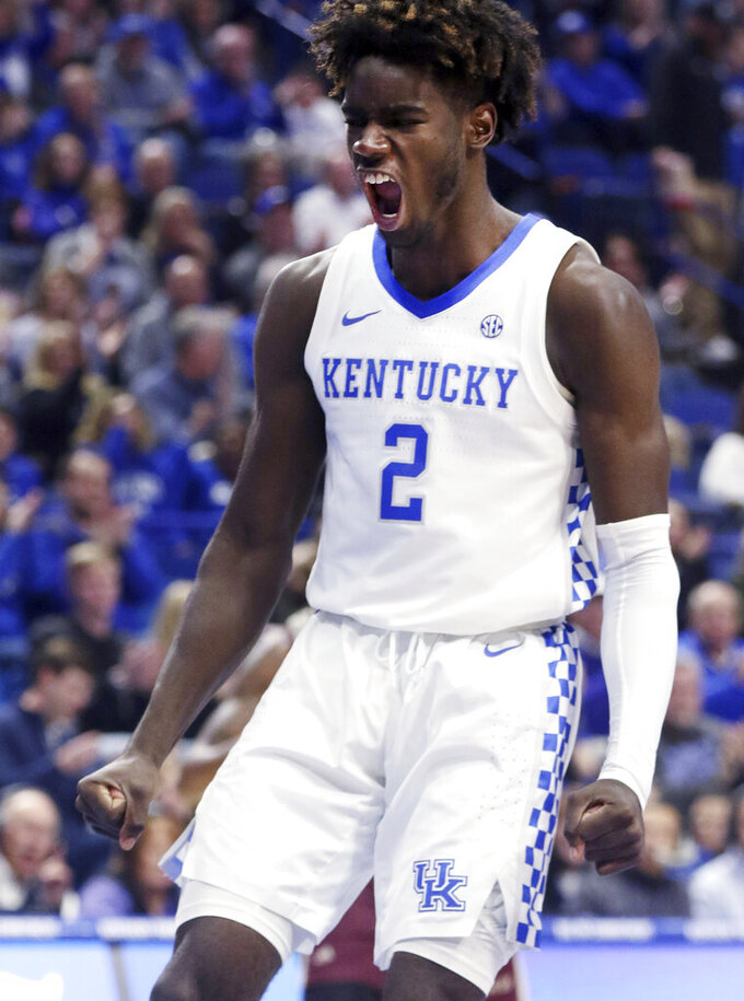 Kentucky's Kahlil Whitney (2) celebrates after a dunk during the first half of an NCAA college basketball game against Eastern Kentucky in Lexington, Ky., Friday, Nov. 8, 2019. (AP Photo/James Crisp)