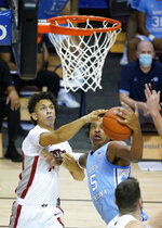 UNLV forward Reece Brown (15) and North Carolina forward Armando Bacot (5) fight for the ball under the basket in the second half of an NCAA college basketball game in the Maui Invitational tournament, Monday, Nov. 30, 2020, in Asheville, N.C. (AP Photo/Kathy Kmonicek)