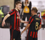 Atlanta United midfielder Julian Gressel, left, celebrates his goal against Herediano with Esequiel Barco during a CONCACAF Champions League soccer match Thursday, Feb. 28, 2018, in Kennesaw, Ga. (Curtis Compton/Atlanta Journal Constitution via AP)