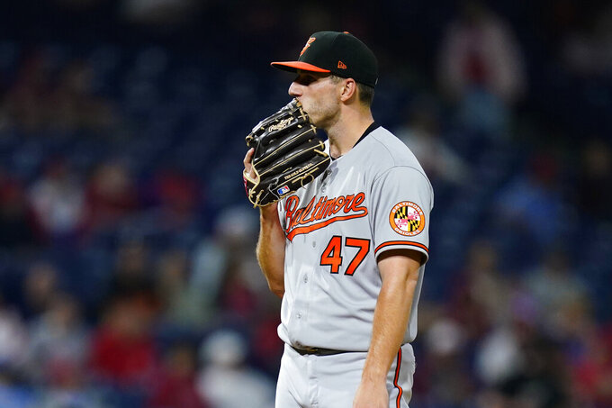 Baltimore Orioles pitcher John Means wipes his face during the seventh inning of an interleague baseball game against the Philadelphia Phillies, Monday, Sept. 20, 2021, in Philadelphia. (AP Photo/Matt Slocum)