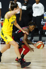 Las Vegas Aces guard Danielle Robinson (3) loses the ball as she tries to drive around Seattle Storm forward Breanna Stewart (30) during the first half of Game 3 of basketball's WNBA Finals Tuesday, Oct. 6, 2020, in Bradenton, Fla. (AP Photo/Chris O'Meara)