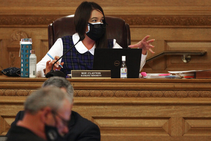 Kansas state Rep. Stephanie Clayton, D-Overland Park, makes a point during a House committee meeting on a bill aimed at overhauling the state's unemployment system, Friday, Feb. 26, 2021, at the Statehouse in Topeka, Kan. Clayton is wary of a Republican proposal to put $450 million in COVID-19 relief funds into unemployment system. (AP Photo/John Hanna)