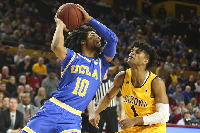 UCLA's Tyger Campbell (10) looks to pass as Arizona State's Remy Martin (1) defends during the first half of an NCAA college basketball game Thursday, Feb. 6, 2020, in Tempe, Ariz. (AP Photo/Darryl Webb)