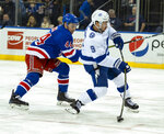 Tampa Bay Lightning's Tyler Johnson takes a shot as he gets past New York Rangers Neil Pionk in the first period of an NHL hockey game Wednesday, Feb. 27, 2019, at Madison Square Garden in New York. (AP Photo/Craig Ruttle)