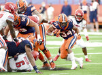 Syracuse running back Sean Tucker (34) carries the ball against Liberty during the first half of an NCAA college football game against Liberty on Saturday, Oct 17, 2020, at the Carrier Dome in Syracuse, N.Y.  (Dennis Nett/The Post-Standard via AP)
