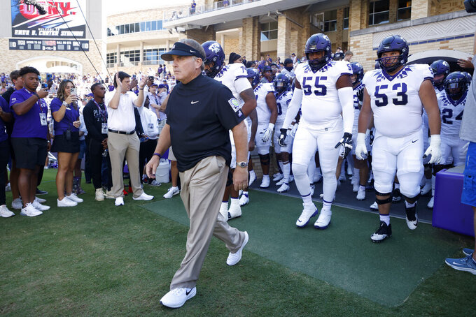 TCU Horned Frogs head coach Gary Patterson leads his team, including offensive tackle Obinna Eze (55) and guard John Lanz (53) onto the field against SMU during an NCAA football game in Fort Worth,Texas, Saturday, Sept. 25, 2021. (AP Photo/Michael Ainsworth)