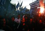 Far-right protesters take part in a rally during the annual state of the economy speech by Greece's Prime Minister Kyriakos Mitsotakis in the northern city of Thessaloniki, Greece, Saturday, Sept. 12, 2020. Mitsotakis outlined plans Saturday to upgrade the country's defense capabilities, including purchases of new fighter planes, frigates, helicopters and weapons systems, amid heightened tensions with neighboring Turkey over rights to resources in the eastern Mediterranean. (InTime News via AP)