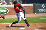 Atlanta Braves' Adam Duvall hits a line drive to left field for a ground rule double during the fourth inning of a baseball game against the Washington Nationals, Sunday, Sept. 6, 2020, in Atlanta. (AP Photo/John Amis)