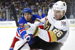 New York Rangers defenseman Tony DeAngelo (77) tries to stop a pass by Vegas Golden Knights center Paul Stastny (26) during the first period of an NHL hockey game, Monday, Dec. 2, 2019, in New York. (AP Photo/Kathy Willens)