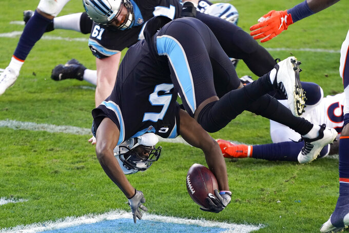 Carolina Panthers quarterback Teddy Bridgewater scores against the Denver Broncos during the second half of an NFL football game Sunday, Dec. 13, 2020, in Charlotte, N.C. (AP Photo/Gerry Broome)