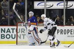 Los Angeles Kings' Trevor Lewis (22) skates past New York Islanders goaltender Thomas Greiss (1) after scoring a goal during the second period of an NHL hockey game Thursday, Feb. 6, 2020, in New York. (AP Photo/Frank Franklin II)