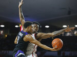 Kansas State guard Kamau Stokes takes an underhand shot in front of Oklahoma forward Kristian Doolittle during the first half of an NCAA college basketball game in Norman, Okla., Wednesday, Jan. 16, 2019. (AP Photo/Sue Ogrocki)