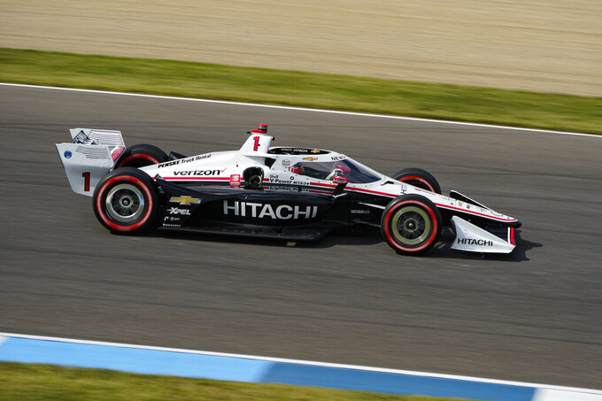 Josef Newgarden drives through a turn during an IndyCar auto race at Indianapolis Motor Speedway in Indianapolis, Saturday, Oct. 3, 2020. (AP Photo/Michael Conroy)