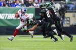 New York Giants' Saquon Barkley evades a tackle by New York Jets' Harvey Langi (44), Marcus Maye (20) and Brandon Copeland (51) during the first half of an NFL football game Sunday, Nov. 10, 2019, in East Rutherford, N.J. (AP Photo/Steven Ryan)