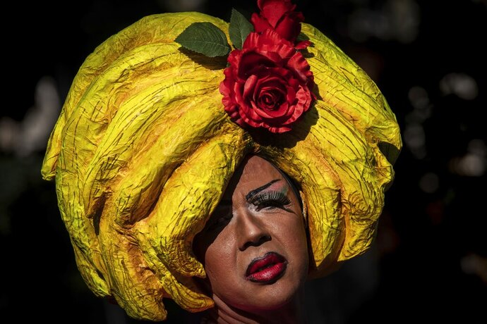 A reveller attends the annual LGBTQ pride parade in Madrid, Spain, Saturday, July 6, 2019. European cities celebrated LGBTQ pride on Saturday with colorful parades that also became platforms for political demands and a push back against far-right populist parties. This year's events in London, Madrid or Budapest mark the 50th anniversary of the Stonewall Inn uprising in New York against police persecution, a turning point in the modern gay rights movement. (AP Photo/Bernat Armangue)