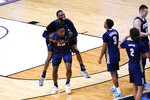 Oral Roberts players celebrate after a college basketball game against Florida in the second round of the NCAA tournament at Indiana Farmers Coliseum, Sunday, March 21, 2021 in Indianapolis. Oral Roberts won 81-78. (AP Photo/AJ Mast)